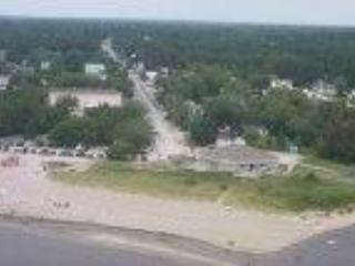 Playa de arena 150 pies de distancia.