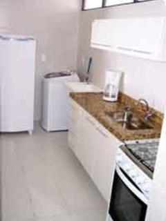 the kitchen with granite worktops, cooker mircowave fridge washing machine  and blender