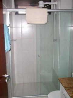 One of three fully tiled bathrooms with showers