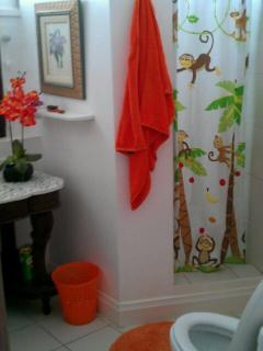 Bathroom with shower and shower chair