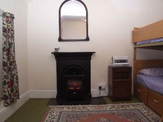 Bedroom with orginal fireplace