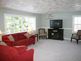 Living Room with fireplace and 50 inch LCD HDTV