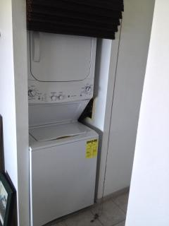 stacked washer and dryer in unit