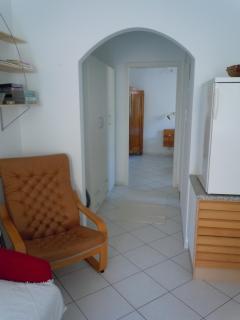 Hallway w large cupboard