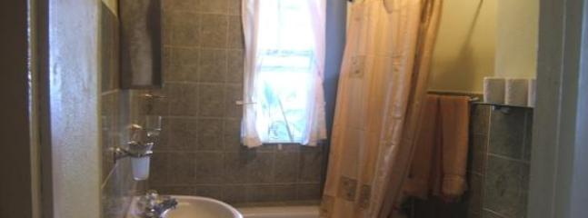 Bathroom with bath tub/shower combo.Hot water