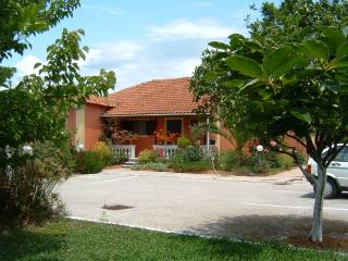House close to the sandy beach on Corfu island, Kavos