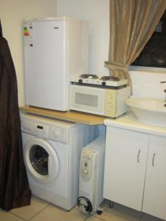 Fridge, Microwave, 2 Plate Cooker, Washing Machine, Heater