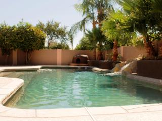 Waterfall and Adobe style fireplace complement the large resort style pool