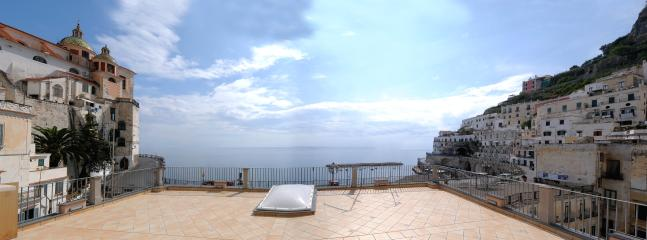 Terrace overlooking the sea and the square