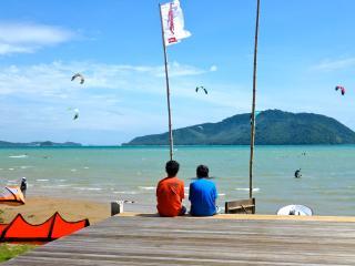 Beachfront kitesurfing action
