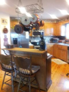 kitchen with new appliances and fully supplied with everything to prepare and serve big meals