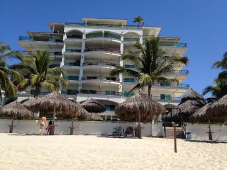 Gorgeous BEACHFRONT 2 BR condo in private building