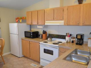 The kitchen is well stocked and has a 12 cup coffee maker and coffee