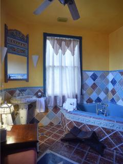 The Casablanca Suite -A premiere room with king size canopy, jetted tub, original working fireplace.