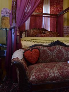 The Madrid Suite - A premiere room with king size canopy, jetted tub, original working fireplace.