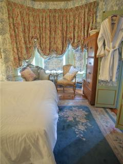 The Paris Suite - A Standard Queen Size room for two with French imported fabrics and canopy bed