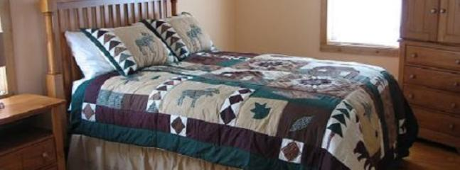 Queen bed in upstairs bedroom