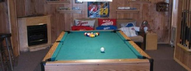 Game room with pool table, puzzles, tv, gas fireplace, and more