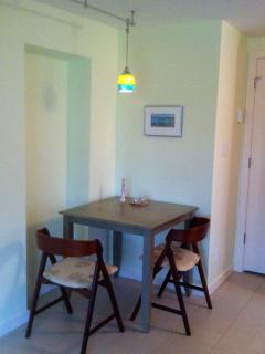 The dining table seats up to four, convenient to the fully equipped kitchen.