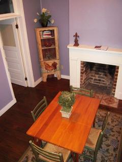 Our quaint dining room has room for four to gather for a lovely meal