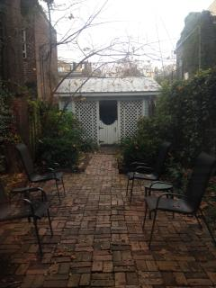 Our peaceful courtyard~ a great way to start your day or unwind after sightseeing.  Includes garage.