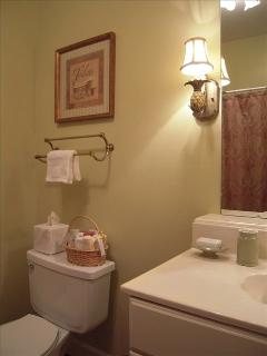 Our full bathroom includes a bathtub, shower and lots of towels.  The half bath has the washer/dryer