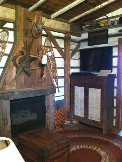 Reclaimed lumber fireplace surround with re-purposed gas fireplace