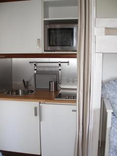 Kitchen with glass ceramic cookers, micro oven grill, fridge with freezer, coffee machine, toaster..