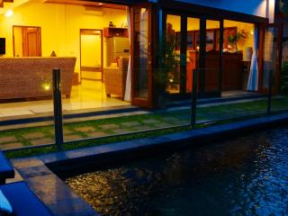 Looking accross your beautiful pool at sunset - pool fence for the kids safety