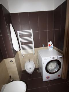 first bathroom with wash / dry machine
