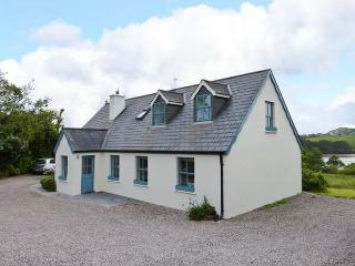 OLD COURT, detached cottage, en-suite, roll-top bath, multi-fuel stoves, superb