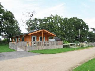 WATERSIDE LODGE, superb, single-storey lodge, woodburner, hot tub, overlooking