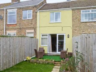 SOUTH VIEW COTTAGE, mid-terrace cottage, open plan living area, enclosed garden,