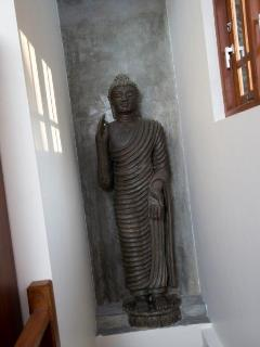 Buddha above the stairs