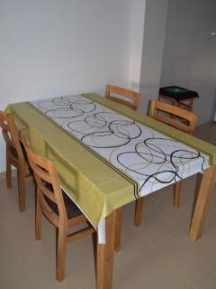 Dining table with 4 wooden chairs with soft seat