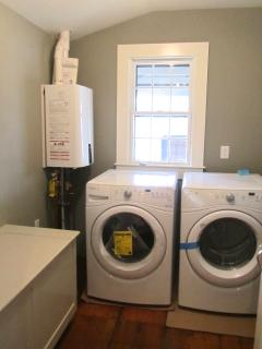 New Utility/Mudroom w/Washer, Dryer, Tankless Hot Water, and Built-in Storage