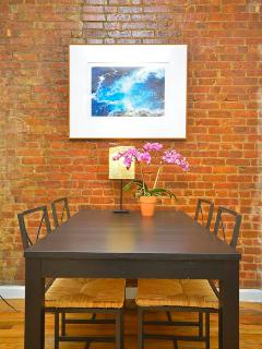 detail of table and original brick wall