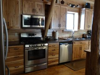 Hickory Kitchen with stainless appliances with all the elements a gourmet chef would want