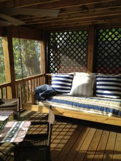 Swing bed on the screen porch