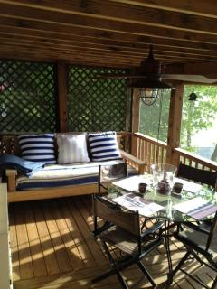 Swign bed and table on the screen porch