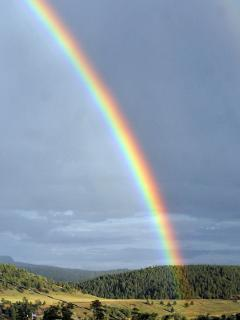 Magical rainbows in the meadow, view from our porch