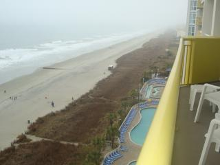 Oceanfront 3-BR condo; accommodates 6-10 people.