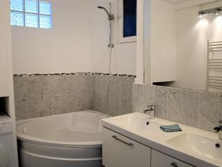 Corner bath, washing machine