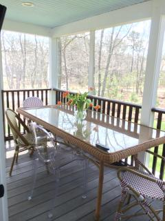 screened in porch with restoration hardware table and french bistro chairs