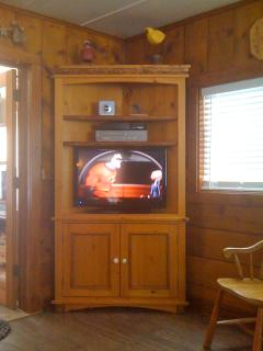 Entertainment Center with Cable TV and DVD/VHS player.