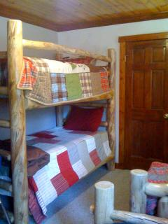 Kids Room with Bunk Beds and Two Single Beds.
