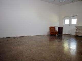 Large open studio space well lit & patio outside