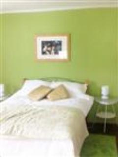 Bed in green bedroom