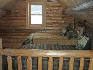 Loft bedroom includes one full size bed and one twin size bed