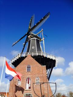 Windmill 'De Adriaan'  just around the corner, open 7 days per week  http://www.molenadriaan.nl/openingstijden